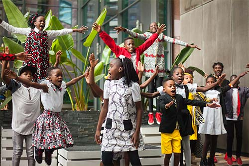 African children singing and dancing