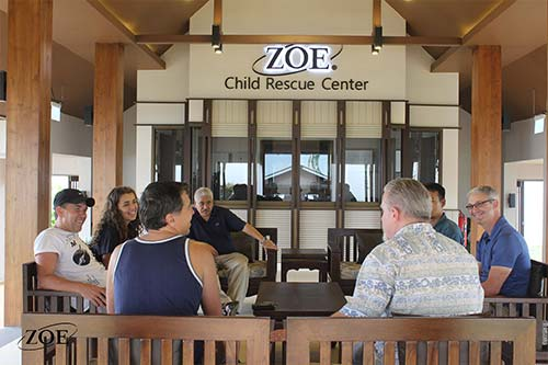 People talking at the Zoe Child Rescue Center