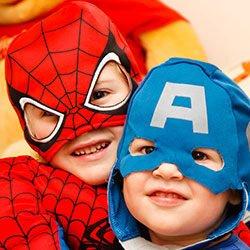 Two children in superhero costumes