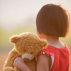 Child and teddy bear
