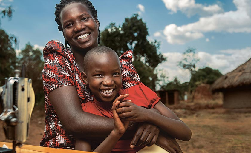 African mother hugging child