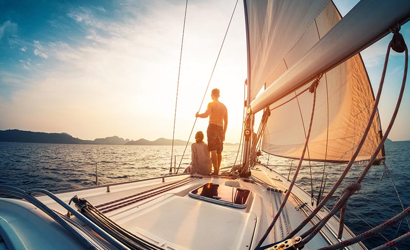 Two people sailing on yacht