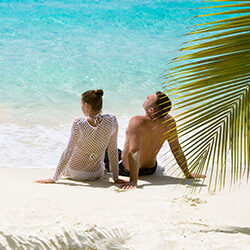 A couple relaxing on a tropical beach